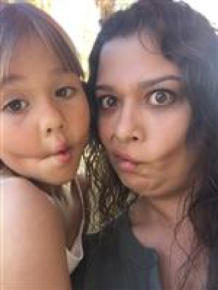 Ms. Ramos and her daughter making a funny face